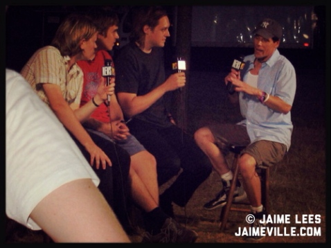 photo by Jaime Lees - Arcade Fire backstage at Lollapalooza 2005 with John Norris of MTV