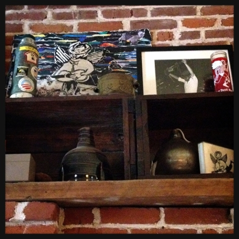 Reuter's ashes (in the bomb) lovingly displayed on Baricevic's mantle. / photo by Jaime Lees