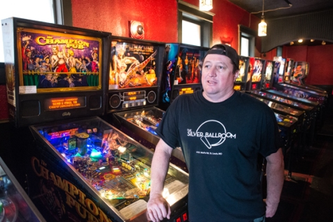 Doc and pinball machines. Photo by Jarred Gastreich for Riverfront Times