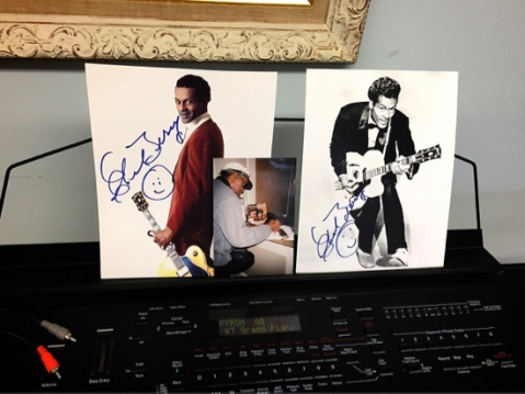 Autographed Chuck Berry photos sit on the keyboard between the guitars. / photo by Jaime Lees