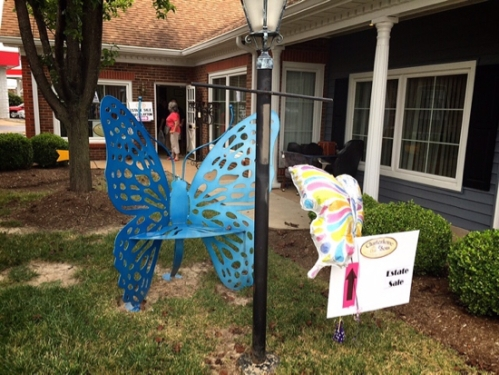 A cheery Bob Cassilly butterfly bench greets visitors at the entrance of Lindstrom & McKenney. / photo by Jaime Lees